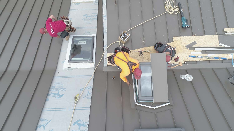 workers on metal roof in San Luis Opispo